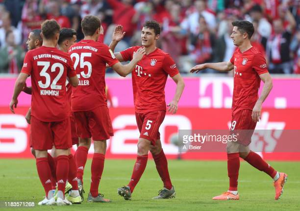 Benjamin Pavard of FC Bayern Muenchen celebrates his first goal with teammates during the Bundesliga match between FC Bayern Muenchen and 1. FC Union...