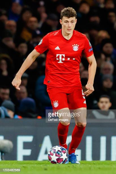 Benjamin Pavard of FC Bayern Muenchen controls the ball during the UEFA Champions League round of 16 first leg match between Chelsea FC and FC Bayern...