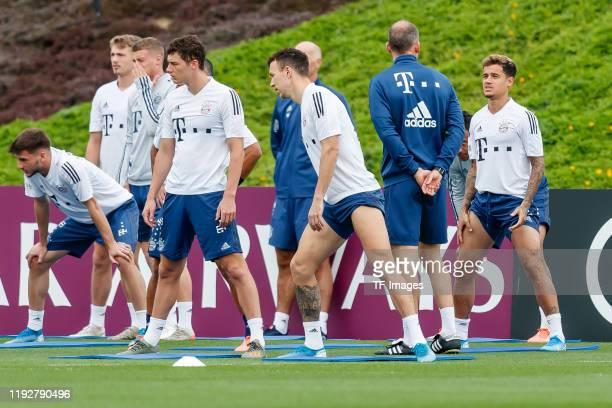 Benjamin Pavard of FC Bayern Muenchen, Jann-Fiete Arp of FC Bayern Muenchen, Dr. Holger Broich of FC Bayern Muenchen and Philippe Coutinho of FC...