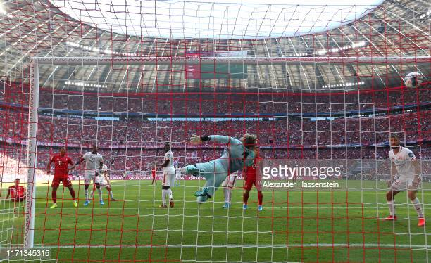 Benjamin Pavard of FC Bayern Muenchen scores the first team goal during the Bundesliga match between FC Bayern Muenchen and 1. FSV Mainz 05 at...