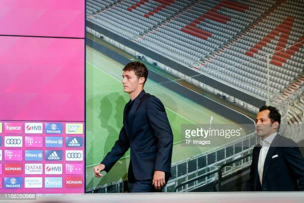Benjamin Pavard of FC Bayern Muenchen sporting director Hasan Salihamidzic of FC Bayern Muenchen look on during a press conference to announce new...