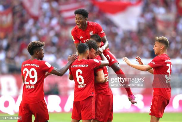 Benjamin Pavard of FC Bayern Munich celebrates after scoring his team's first goal during the Bundesliga match between FC Bayern Muenchen and 1. FSV...