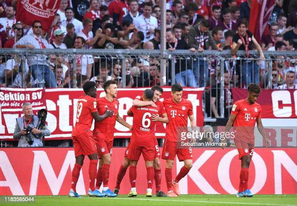 Benjamin Pavard of FC Bayern Munich celebrates with teammates after scoring his team's first goal during the Bundesliga match between FC Bayern...