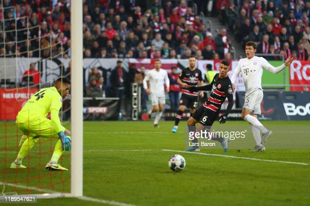 Benjamin Pavard of FC Bayern Munich scores his team's first goal during the Bundesliga match between Fortuna Duesseldorf and FC Bayern Muenchen at...