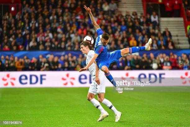 Benjamin Pavard of France and Arnor Ingvi Traustason of Iceland during the international friendly match between France and Iceland on October 11 2018...
