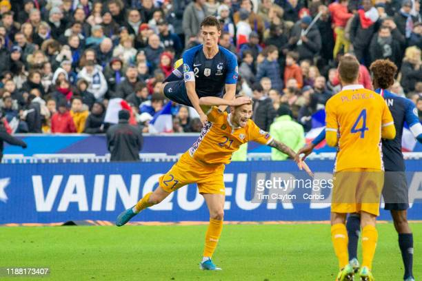 Benjamin Pavard of France and Eduardo Nicolae Milinceanu of Moldova challenge for the ball during the France V Moldova 2020 European Championship...