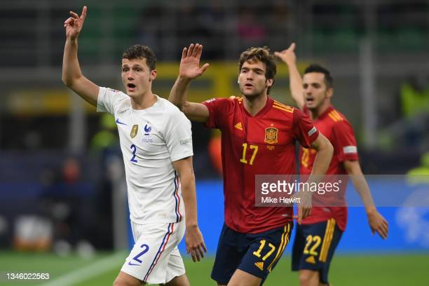 Benjamin Pavard of France and Marcos Alonso and Pablo Sarabia of Spain all claim a throw in during the UEFA Nations League 2021 Final match between...