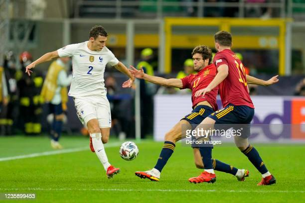 Benjamin Pavard of France and Marcos Alonso of Spain battle for the ball during the UEFA Nations League Final match between the Spain and France at...