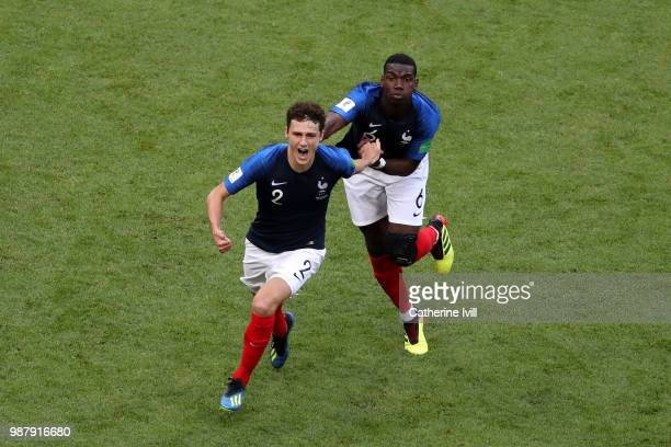 Benjamin Pavard of France celebrates with teammate Paul Pogba after scoring his team's second goal during the 2018 FIFA World Cup Russia Round of 16...