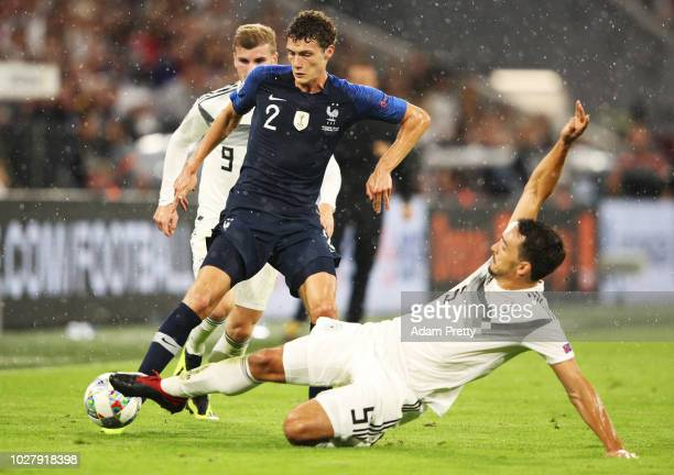 Benjamin Pavard of France is tackled by Mats Hummels of Germany during the UEFA Nations League group A match between Germany and France at Allianz...