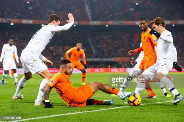 Benjamin Pavard of France Memphis Depay of Holland Georginio Wijnaldum of Holland Antoine Griezmann of France during the UEFA Nations League A group...