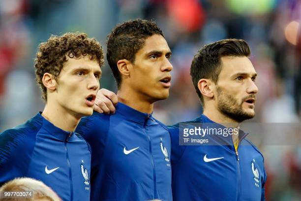 Benjamin Pavard of France Raphael Varane of France and goalkeeper Hugo Lloris of France look on prior to the 2018 FIFA World Cup Russia Semi Final...