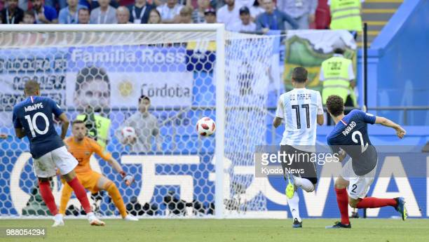Benjamin Pavard of France scores his team's second goal during the second half of a World Cup roundof16 match against Argentina in Kazan Russia on...