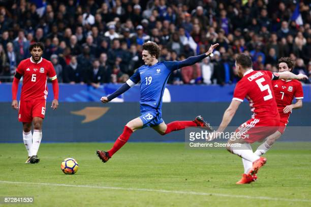 Benjamin Pavard of France shoots the ball against James Chester of Wales during the international friendly match between France and Wales at Stade de...