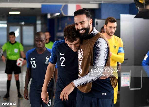 Benjamin Pavard of France speaks with Adil Rami of France in the tunnel at half time during the 2018 FIFA World Cup Russia Semi Final match between...