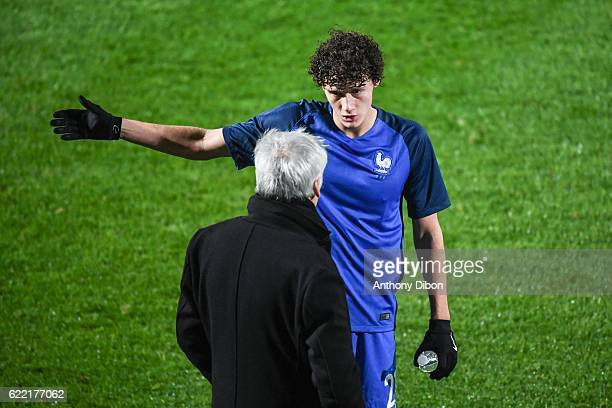 Benjamin Pavard of France talks with coach of France Pierre Mankowski during the International friendly match between France and Ivory Coast on...