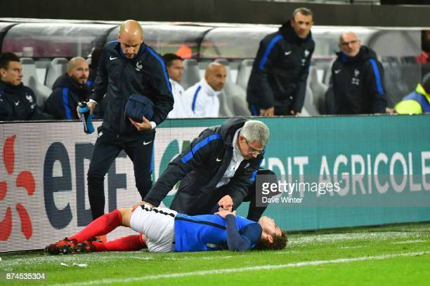 Benjamin Pavard of France us treated by France team doctor Franck Le Gall during the international friendly match between Germany and France at...