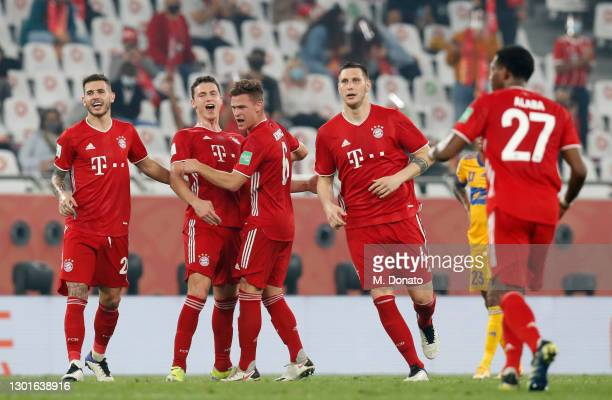 Benjamin Pavard of Muenchen celebrates his team's first goal with teammates during the FIFA Club World Cup Qatar 2020 final between Bayern Muenchen...