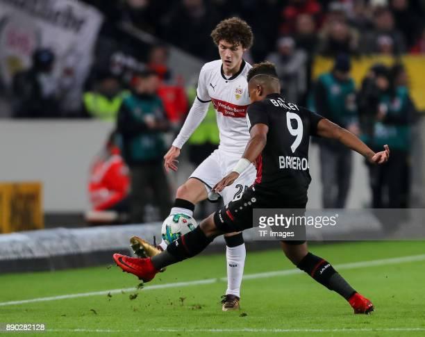Benjamin Pavard of Stuttgart and Leon Bailey of Bayer Leverkusen battle for the ball during the Bundesliga match between VfB Stuttgart and Bayer 04...