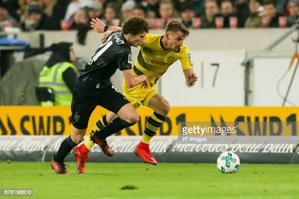 Benjamin Pavard of Stuttgart and Maximilian Philipp of Dortmund battle for the ball during the Bundesliga match between VfB Stuttgart and Borussia...