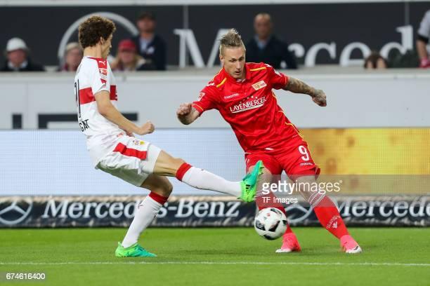 Benjamin Pavard of Stuttgart and Sebastian Polter of Union Berlin battle for the ball during the Second Bundesliga match between VfB Stuttgart and 1...