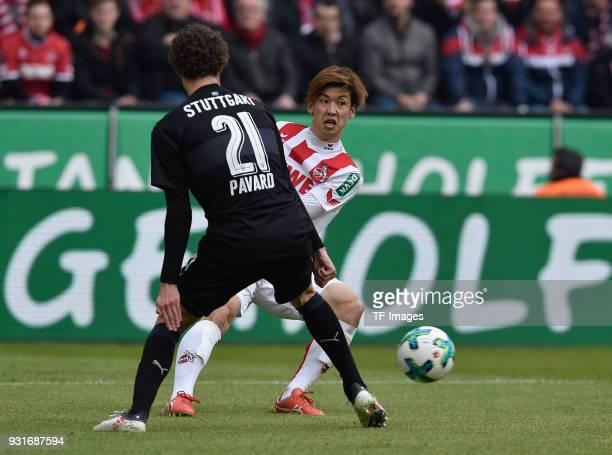 Benjamin Pavard of Stuttgart and Yuya Osako of Koeln battle for the ball during the Bundesliga match between 1 FC Koeln and VfB Stuttgart at...