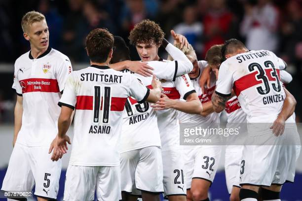 Benjamin Pavard of Stuttgart celebrates with his teammates after scoring his team's second goal to make it 20 during the Bundesliga match between VfB...