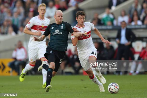 Benjamin Pavard of Stuttgart challenges Davy Klaasen of Bremen during the Bundesliga match between VfB Stuttgart and SV Werder Bremen at MercedesBenz...