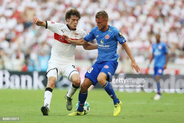 Benjamin Pavard of Stuttgart fights for the ball with Daniel Borsinski of Mainz during the Bundesliga match between VfB Stuttgart and 1 FSV Mainz 05...