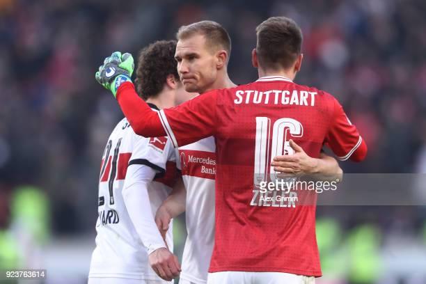 Benjamin Pavard of Stuttgart Holger Badstuber of Stuttgart and RonRobert Zieler of Stuttgart celebrate after the Bundesliga match between VfB...