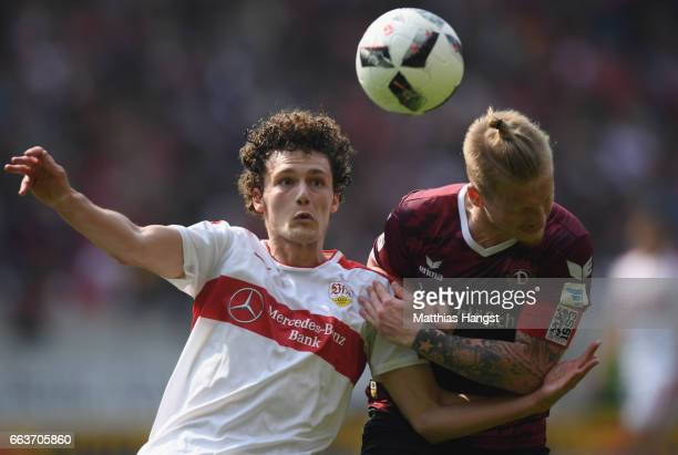 Benjamin Pavard of Stuttgart is challenged by Marvin Stefaniak of Dresden during the Second Bundesliga match between VfB Stuttgart v Dynamo Dresden...