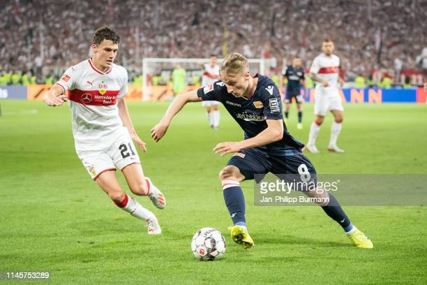 Benjamin Pavard of VfB Stuttgart and Joshua Mees of 1 FC Union Berlin during the Bundesliga relegation/promotion playoff first leg between VfB...