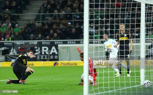 Benjamin Pavard of VfB Stuttgart scores an own goal for Borussia Moenchengladbach's third during the Bundesliga match between Borussia...