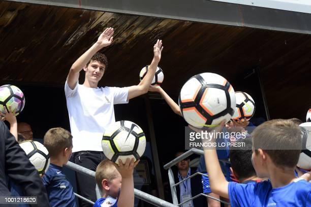 TOPSHOT Benjamin Pavard waves to the crowd in his home town of Jeumont northern France on July 18 2018 three days after French players won the Russia...