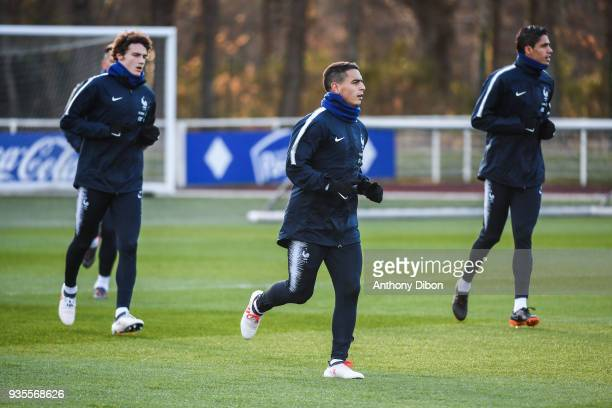 Benjamin Pavard Wissam Ben Yedder and Raphael Varane of France during training session at Centre National du Football on March 20 2018 in...