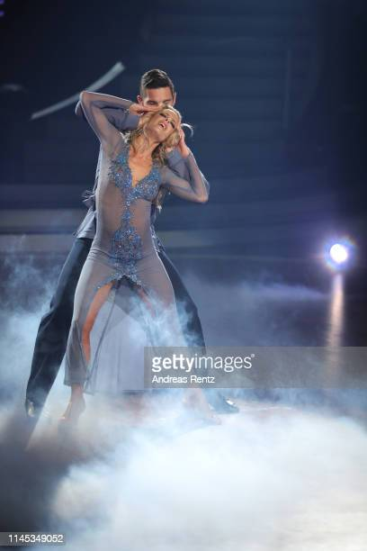 """Benjamin Piwko and Isabel Edvardsson perform on stage during the 5th show of the 12th season of the television competition """"Let's Dance"""" on April 26,..."""