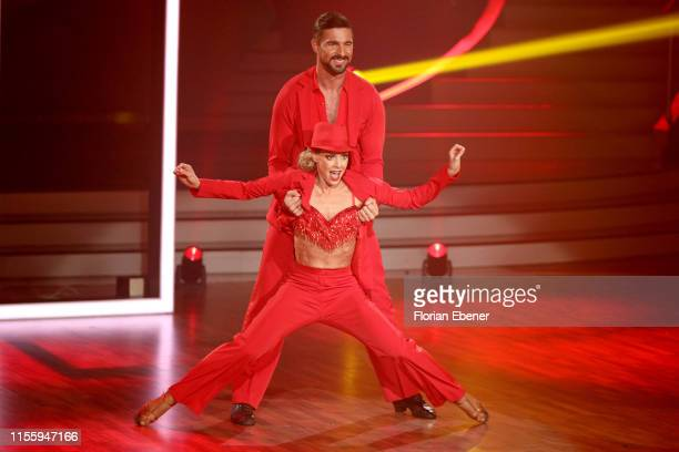 """Benjamin Piwko and Isabel Edvardsson perform on stage during the finals of the 12th season of the television competition """"Let's Dance"""" on June 14,..."""