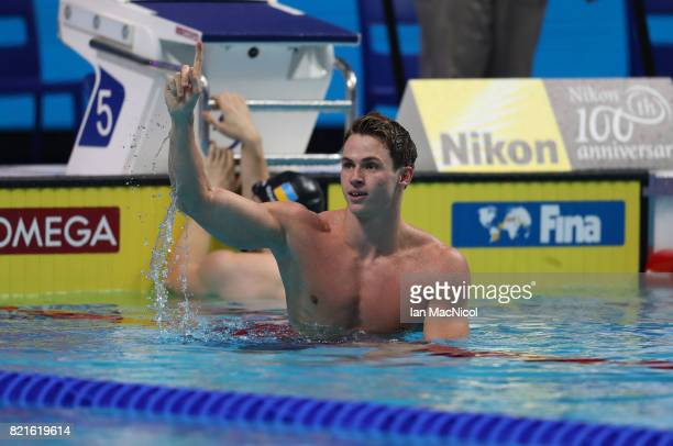 Benjamin Proud of Great Britain celebrates winning the final of Men's 50m Butterfly on day eleven of the FINA World Championships at the Duna Arena...