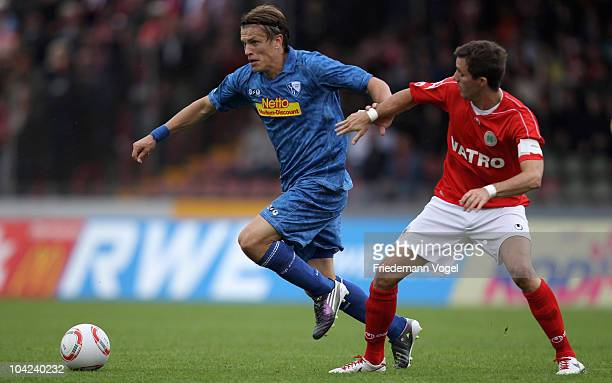 Benjamin Reichert of Oberhausen and Zlatko Dedic of Bochum battle for the ball during the Second Bundesliga match between RW Oberhausen and VfL...