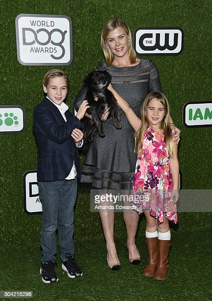 Benjamin Sanov Ozzie the dog actress Alison Sweeney and Megan Sanov arrive at the 2016 World Dog Awards at Barker Hangar on January 9 2016 in Santa...