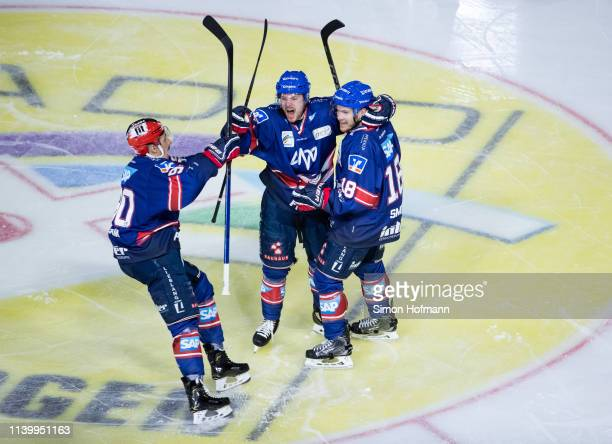Benjamin Schmid of Mannheim celebrates his team's first goal with his team mates during game one of the DEL PlayOffs Semi Final between Adler...