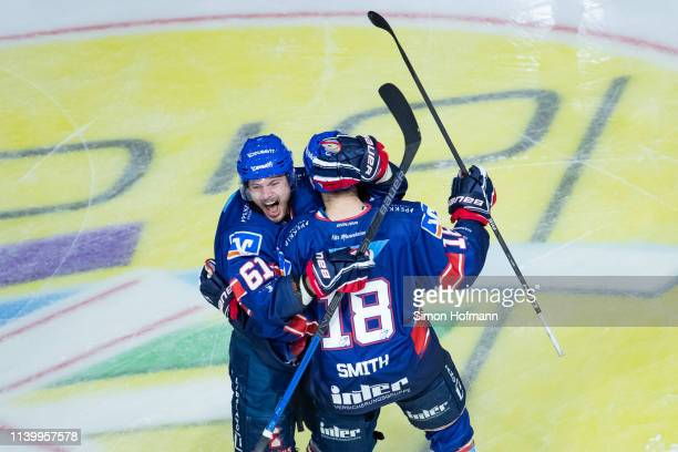 Benjamin Schmid of Mannheim celebrates his team's first goal with team mate Tommi Huhtala during game one of the DEL PlayOffs Semi Final between...