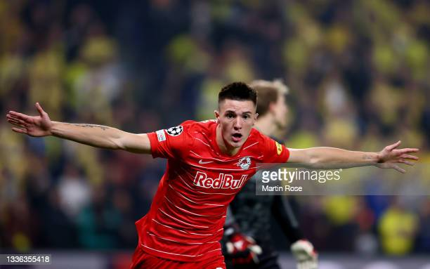 Benjamin Sesko of FC Red Bull Salzburg celebrates after he scores his team's opening goal during the UEFA Champions League Play-Offs Leg Two match...