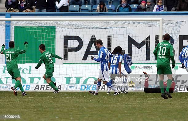 Benjamin Siegert of Muenster scores the first goal during the third league match between FC Hansa Rostock and Preussen Muenster at DKBArena on...