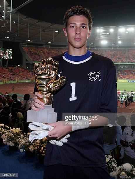 Benjamin Siegrist of Switzerland poses with the Golden Glove Award after the FIFA U17 World Cup Final between Switzerland and Nigeria at the Abuja...