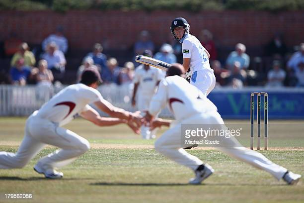 Benjamin Slater of Derbyshire looks back as he edges a delivery from Alfonso Thomas of Somerset which is fielded by Marcus Trescothick and Nick...
