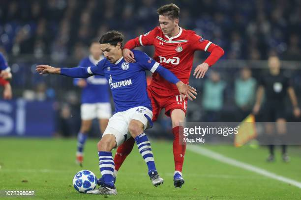 Benjamin Stambouli of FC Schalke 04 battles for possession with Anton Miranchuk of Lokomotiv Moscow during the UEFA Champions League Group D match...