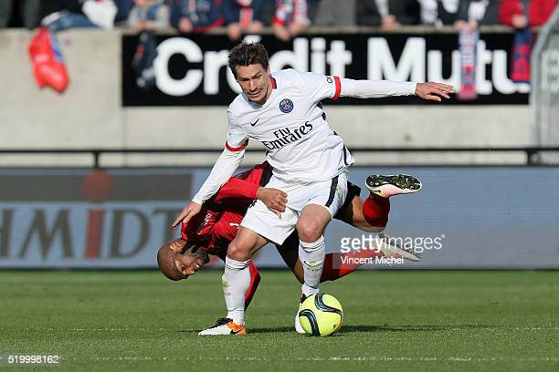 Benjamin Stambouli of Paris SaintGermain and Jimmy Briand of Guingamp during the French League 1 match between EA Guingamp and Paris SaintGermain on...