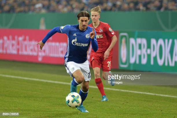 Benjamin Stambouli of Schalke and Chris Fuehrich of Koeln battle for the ball during the Bundesliga match between FC Schalke 04 and 1 FC Koeln at...