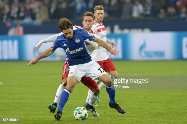 Benjamin Stambouli of Schalke and Luca Waldschmidt of Hamburg battle for the ball during the Bundesliga match between FC Schalke 04 and Hamburger SV...